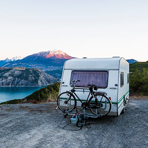 camper on edge of cliff with bike